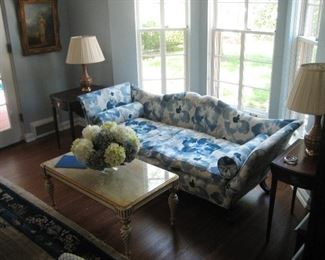 Newly upholstered vintage settee and Hollywood Regency cocktail table