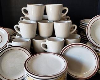 """https://ctbids.com/#!/description/share/422387 Onedia Classic set includes: 24 cups, 24 saucers, 24 bowls, and 12 plates. """"These little plates were inspired by a 1960's style, with red specks on an ivory white base, and striped edges. The ceramic material has reinforced edges for resistance to chips. For professional food service or home dining, these charming plates have a retro appeal that all will enjoy."""""""