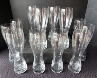 """https://ctbids.com/#!/description/share/422385 12 Count: Wheat Beer 23.5 Oz Glasses By Stölzle Lausitz. """"The strong, narrow base and sophisticated curvature is designed specifically for wheat beers. The top lip creates a thick foam head to trap the distinct aroma and flavors of your best beer. The carefully contoured design makes this glass ergonomic and easy to carry for an excellent tasting experience. Each of Stolzle's glass products undergoes a special fire tempering process to increase durability and reduce the risk of breakage."""""""