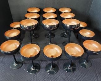 """https://ctbids.com/#!/description/share/422408 18 Count: """"Glisten"""" 8 oz Matte Black/Copper Coupe Cocktail Glasses. 8 oz. Glisten matte black / copper coupe cocktail glass. """"This coupe cocktail glass features a shallow, broad bowl and long, slender stem. A matte black exterior pairs with a glistening copper interior for a formal, yet fun, presentation, fit for trendy bars, upscale events, and festive celebrations."""""""