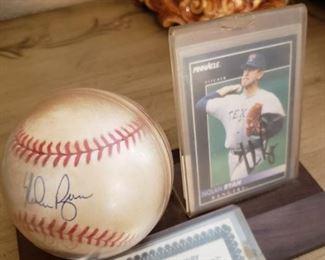 Lot 111    Autographed Nolan Ryan Baseball and Card with COA    $100