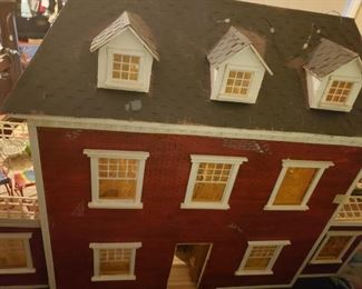 #135   $300  Vintage doll house about 3ft wide 2 ft tall 12 deep. Has extraordinary contents right down to miniature cookbook and Monoploy game. Rare find like this