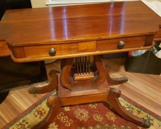 #135     $400    Antique Lyre base table About 4 ft wide 20 deep 30 tall. Dovetailed drawers and brass pawfoot feet