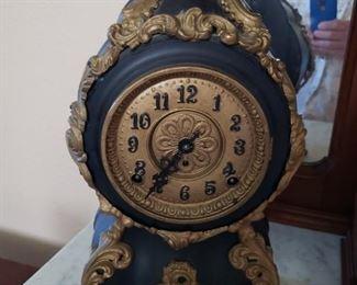 #145    Working Antique Cast Iron Clock  $200