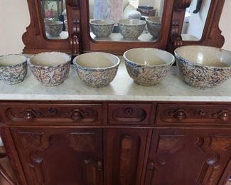 #148   Graduated set of antique Red Wing Spongeware Bowls with advertising.  $400