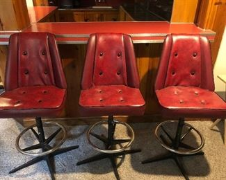 3 of the 6 in a set of bar stools