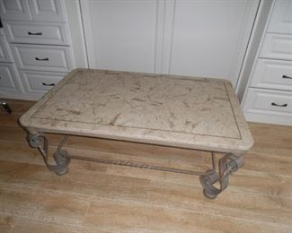 $125.00         Large rectangular coffee table, metal base, faux stone top