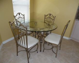 $225.00          Dinette Set, Glass top Table,Metal chairs