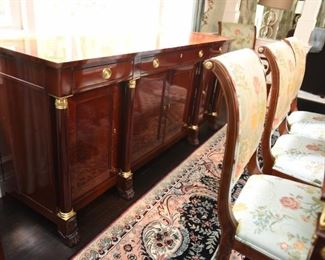 """ITEM 3: Kindel Neoclassical Sideboard  $425: Matches dining table, breakfront and chairs. Center drawer locks and has silver storage. This piece has sun fading on the top back edge nearest the window. Otherwise in very good condition. 76"""" long x 21"""" deep, x 34.5"""" tall"""