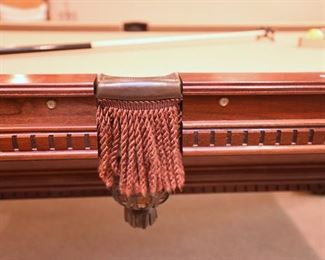 ITEM 41: Eight Foot Leather Pocket Pool Table  $450 Unmarked. Three-piece slate top. Currently covered in beige felt. Balls and cues included. Professional mover required.