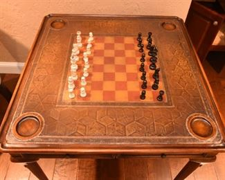 """ITEM 42: Theodore Alexander Game Table  $875 Model #5205-018 Very good condition. Leather top embossed with a checkered game board. 32"""" x 32"""" square table, 31"""" tall"""