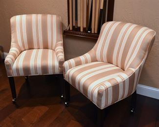 """ITEM 43: Pair Upholstered Chairs on Casters $295 Orange/copper and brown/bronze striped chairs. 24"""" x 18"""" x 34.5"""" tall"""