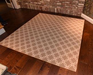 ITEM 54: Tan and White Area Rug  $95 Berber area rug, 6' x 6'