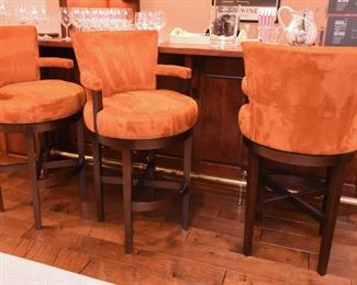 ITEM 63: Three Orange Faux Suede Swivel Bar Stools  $550 Good condition. Some dings to dark wood, can be fixed with a wood stain pen.
