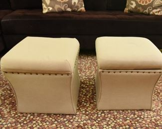 """ITEM 75: Two Storage Ottomans  $48 Cream color fabric with nailhead trim. Each is 16"""" square, 16.5"""" tall."""