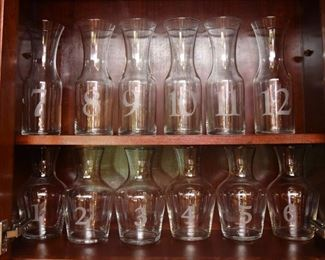 ITEM 82: Set of 12 Numbered Wine Carafes  $75 An absolute must for wine tasting. Numbers are etched into the glass.