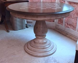 """ITEM 84: Pedestal Game Table   $245 Blue/gray painted pedestal. Natural wood top, stenciled game field. 41"""" round, 30.5"""" tall. This hasn't been in the basement long - the stagers moved it down there a few weeks ago."""