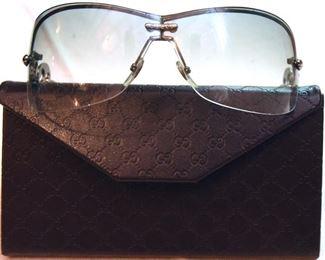 ITEM 89: Gucci Rimless Shield Sunglasses  $65