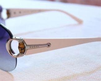 ITEM 94: Gucci Shield Sunglasses  $30