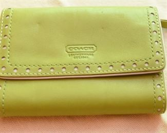ITEM 95: Coach Lime Green Tri-Fold Wallet  $16