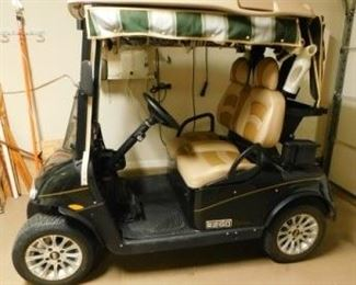 """2013 EZ-Go Custom Golf Cart - Features leather seats, canopy, 2 glove boxes, custom wheels, front windshield, golf bag holder on the back and other little """"extras"""".  Excellent condition and runs great!  We are accepting offers and the best offer gets it at the end of the sale.   Current offer is $3800.  Next offer must be $3900 or more.  Price will be updated as new offers are made.  Email us or call 512-954-3050 to buy it now at $7500 or make an offer."""