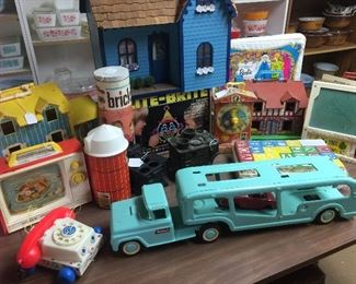 Fischer price house with accessories, Barn with accessories, Buddy L car hauler, Doll houses 2 metal Doll houses, Vintage Barbie cases, Barbie Airplane, Dolls, MANY original board games Fishcer price homes and barn have accessories and figures with