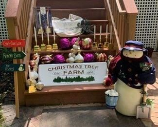 Soft Snowman $30 ; 5 Boxes (10) LED Battery Candles $75 ; Big Glass Ornaments $2 ea. ; Christmas Tree Farm Sign $18 ; Christmas Tree Farm Bag $8 ; Wintertime Sprigs $8 ; Candy Cane Sign $10