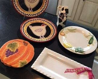S/2 Chicken Plates by Becky Danny $16; Moo Pitcher $10; Portuguese Veggie Plate $10; Pair Pumpkin Trivets $8; Ribbon Platter $10