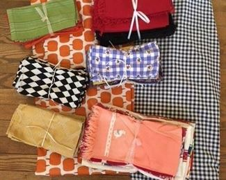 Sets of 4 Napkins $6; Pairs of Napkins $3; Packs of 3 Towels $9; Pack of 20 Napkins Red and Black $28; Pumpkin Plastic Cloth w Felt backing $8; Blue Gingham Cloth $14