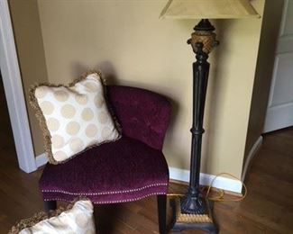 Plum Upholstered Occasional Chair $35; Pair of Beautiful Cream and Gold Pillows $35; Resin Standing Lamp $55