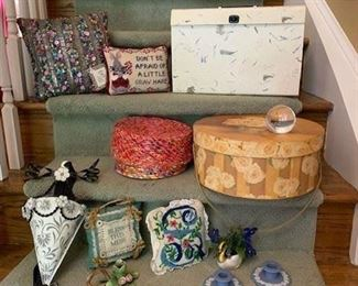 Jazzy Pillow $6; Needlepoint Pillow $4; Paperwork Case $4; Recycled Paper Box $4; Set of 2 Hat Boxes $6; Tole wall mounted Container $5; Bless Pillow $3 ; Small Candlestick $3; Needlepoint pillow $4; Bead Work violets in ceramic Swan $8 ;  Pair Wedgwood Jasperware Candlesticks $14 ; Waterford Crystal Tennis Ball $10