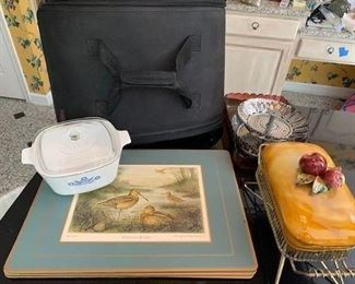 Pampered Chef Casserole Carrier $12; Corning Lidded Casserole $5; Set of 4 Pimpernel Place mats $10; Glass Serving Tray ( not for oven use) together with Two Tiered Steamer $5; American Ceramic Lidded Bread Pudding Server $10