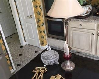 Etched and Cut Glass Covered Bowl $22; Single Silver Painted Candlestick Lamp $10; Pair Brass Decorative Bowls $18; London Coat of Arms Brass Travel $20