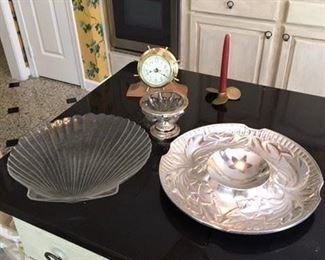 Brass Captains Wheel Clock with Brass Propeller Candle Holder $10; Chrome and Glass Small Pedestal Dish $5; Glass Shell Form Dish $10; Wilton Pewter Chip and Dip Tray $18