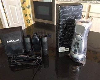 Meade Binoculars, allows you to photo what you see! Together w Hand Charging Radio, boxed. $28