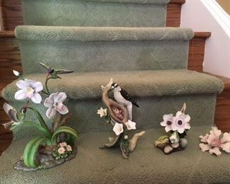 Maruri Studios Hummingbirds and Orchids $48; Boehm woodpecker and babies $58; signed Boehm anemone $48; German porcelain orchid $38