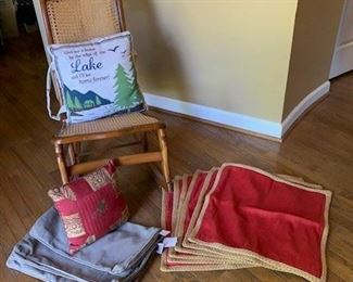 Vintage fruitwood caned rocker $45; Lake pillow $10; Monkey pillow $10; 3 taupe Sunbrella cushion cover $16; 6 NWT Pottery Barn shams $40