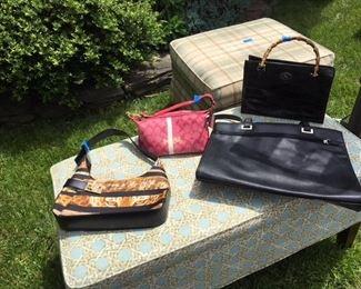Ferragamo bag $300; pink Coach bag $20; Dooney Bourke alligator black bag $40; large Coldwater Creek black bag $20