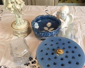 Lenox angel music box $55; Waterford 2002 $18; Japanese lobed bowl $25; unmarked kneeling angel $16; Frosted glass angel $6; porcelain flower arranger $16