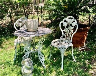 Vintage wrought iron patio furniture set, excellent condition.  large outdoor pots/plants and cement figurines.