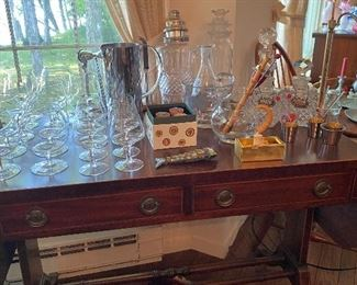 Antique mahogany drop leaf table with assorted vintage and antique bar ware
