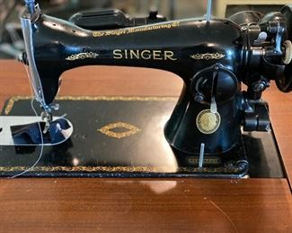 Running condition antique Singer sewing machine and cabinet