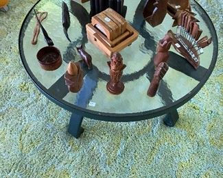 Vintage patio table with various vintage carved wood pieces.