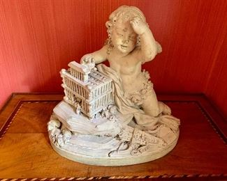 "$1,800 18th Century French white terra-cotta figural group depicting a cupid holding a dove cote.  Signed. Approx 15"" H."