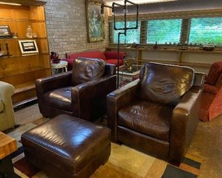 Pair of Thomasville leather club chairs with ottoman.