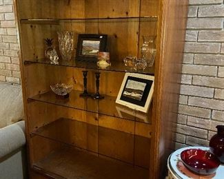 Nice wooden display unit with glass shelves and lighting.