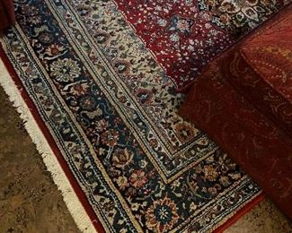 Area rug with deep red and blue tones.