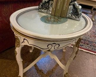 Painted antique table with framed glass top.