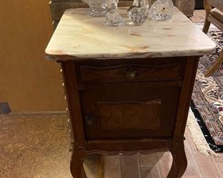 Marble top side table. Waterford pieces.