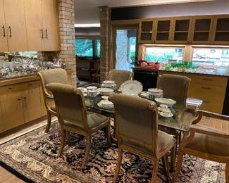 INCREDIBLE glass topped pedestal dining table! With 6 upholstered chairs.